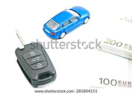 blue car, euro notes and car keys on white - stock photo