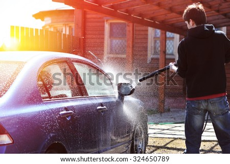 Blue car washing on open air - stock photo