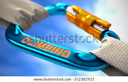 Blue Carabine with White Ropes on Sky Background, Symbolizing the Climbing. Selective Focus. - stock photo