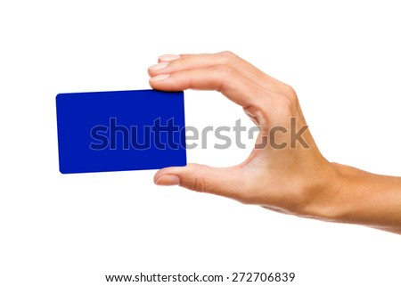 Blue card in woman's hand. Close up of woman's hand holding blank blue card. Studio shot isolated on white. - stock photo