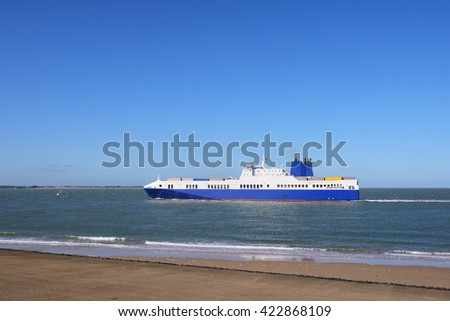 Blue cargo ship sailing to Antwerp port by the coast of Vlissingen, Netherlands - stock photo