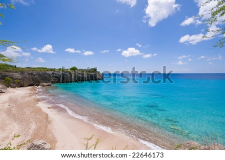 blue caribbean bay view  with a nice deserted beach - stock photo