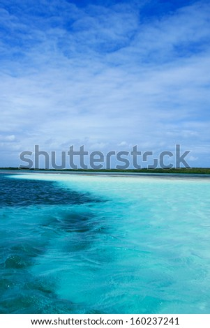 Blue caribbean water on a sand bank, Dominican Republic - stock photo
