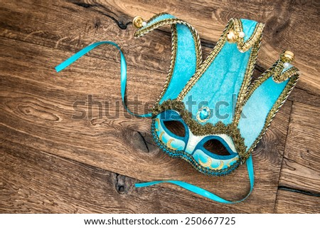 Blue carnival mask harlequin. Holidays background. Symbol of venetian mask festival - stock photo