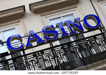 Blue casino signboard on a street of city - stock photo