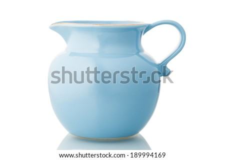 Blue ceramic pitcher isolated on white. - stock photo
