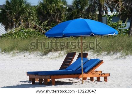 Blue Chair and umbrella on Florida Gulf Coast. Madeira Beach Florida - stock photo