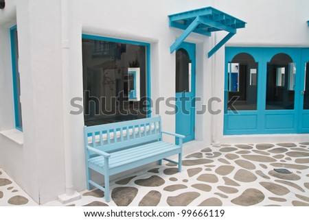 Blue chair on pathway - stock photo