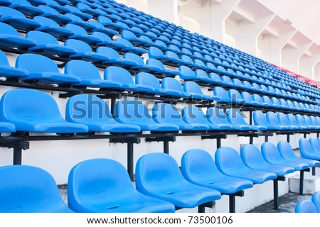 Blue chair. On the miraculous. To watch a sporting event. - stock photo
