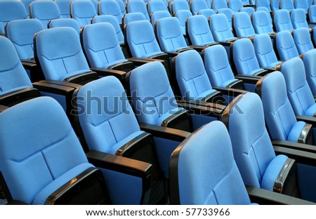 blue chair seats in an empty conference room - stock photo