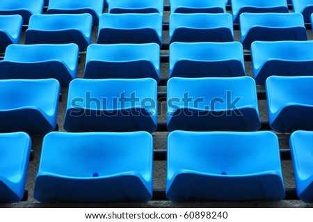 blue chair seats in an empty Stadium Seats , stand - stock photo