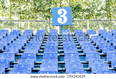 blue chair stadium - stock photo