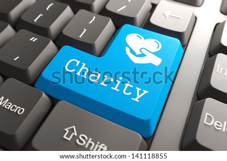 Blue Charity Button on Computer Keyboard. Social Concept. - stock photo