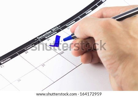 Blue check. Mark on the calendar at 25 December 2013 - stock photo