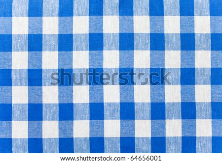 blue checked fabric tablecloth - stock photo
