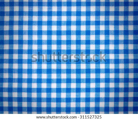Blue checker tablecloth with dark vignette  for background - stock photo