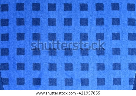 Blue checkered fabric useful as a background