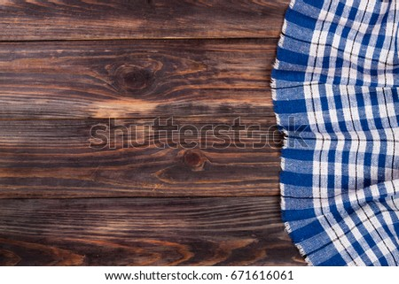 Blue Checkered Tablecloth On The Black Wooden Table With Copy Space For  Your Text. Top