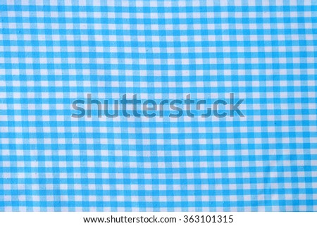 Blue Checkered Tablecloth (The pattern on this fabric is common in Thailand and is not subjected to copyright) - stock photo