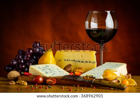 Blue Cheese, gorgonzola, morbier, grapes and red glass wine