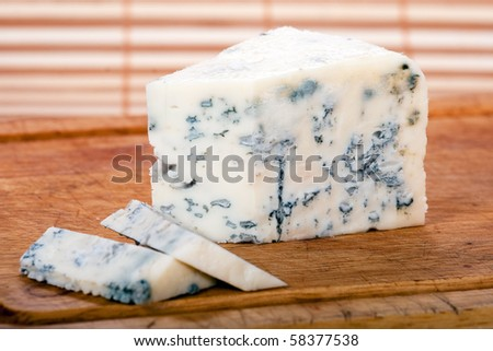 Blue cheese on cutting wood - stock photo