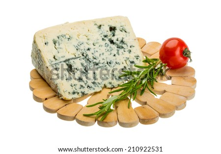 Blue cheese on the desk - stock photo