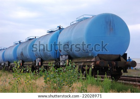 Blue chemical tank train wagon - stock photo