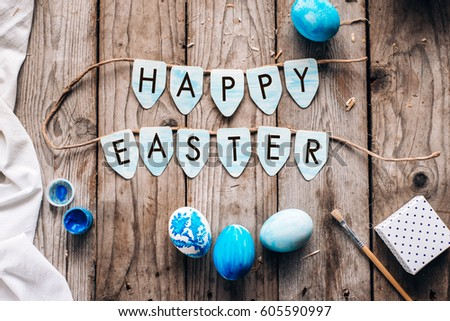 Blue Chicken Easter Eggs And The Same Text Happy On Rustic Wooden Background