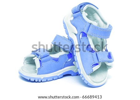 Blue child's sandals isolated on white - stock photo