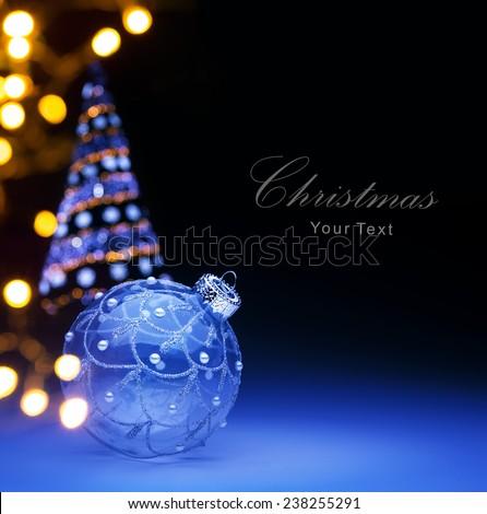 Blue Christmas ball and Christmas holidays lights - stock photo