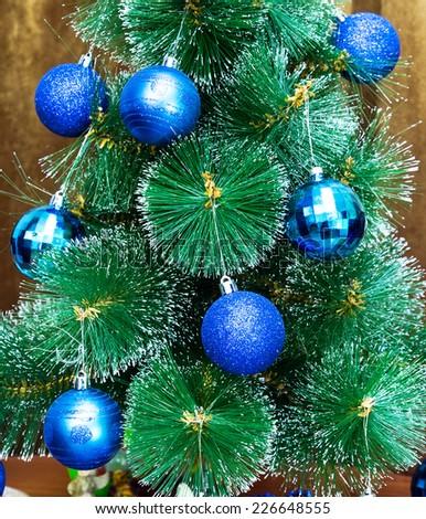 Blue christmas ball on fir branches. xmas decoration - stock photo
