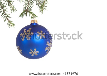 Blue christmas ball on green fir branch over white isolated