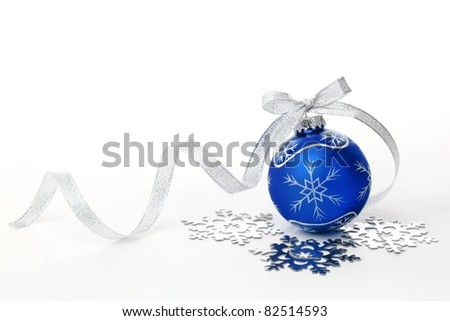 Blue christmas ball with silver ribbon bow and snowflake on white background. - stock photo