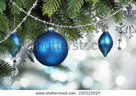 Blue Christmas balls hanging on fir tree - stock photo