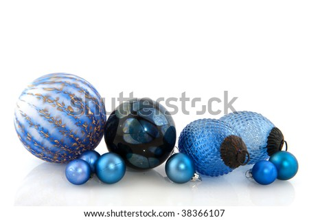 Blue christmas balls in different sizes isolated over white