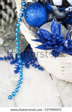 Blue Christmas balls in white wooden basket on white - stock photo