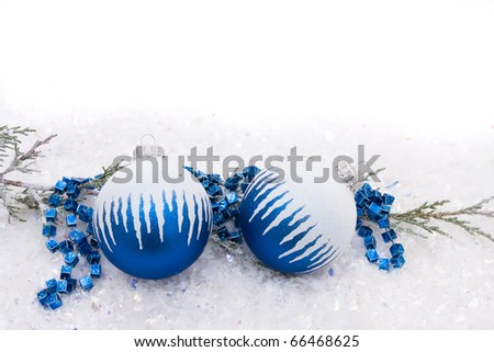 Blue christmas balls on a snow background, christmas time