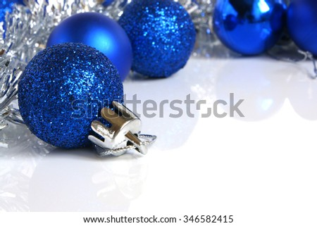 Blue christmas balls on a white background - stock photo