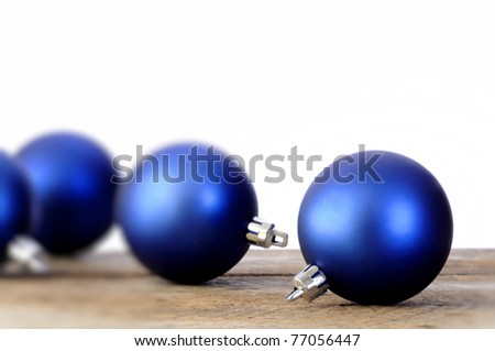 Blue Christmas balls on an old vintage table
