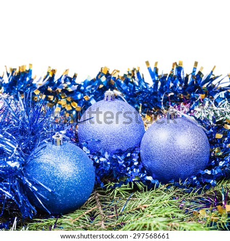 blue Christmas balls on green fir tree branch isolated on white background - stock photo