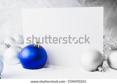 Blue Christmas balls on the white snow - stock photo