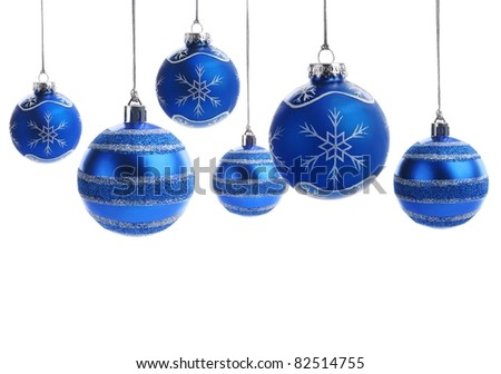 Blue christmas balls over white background - stock photo