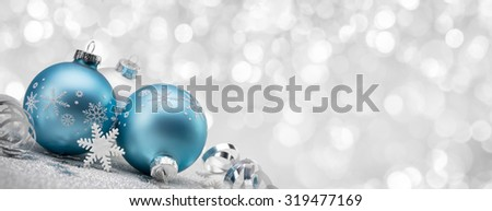 Blue Christmas balls with decoration on shiny background - stock photo
