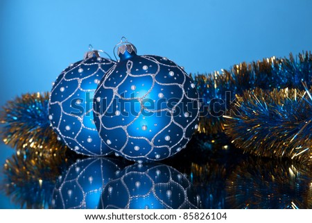blue christmas balls with tinsel on a dark blue background - stock photo