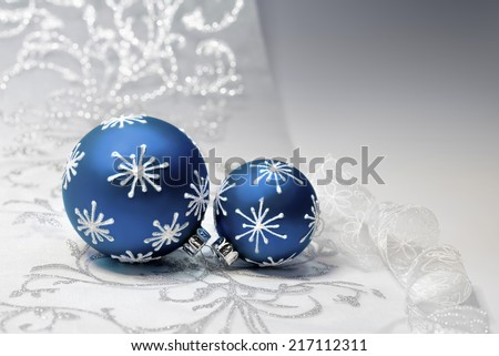 Blue Christmas baubles with silver ornament on silver background, text space. Shallow DOF, focus on the knot  - stock photo