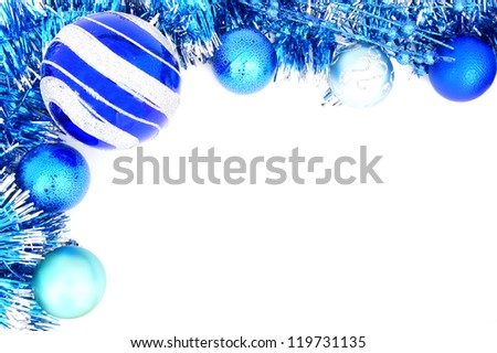 Blue Christmas  border of baubles and shiny garland - stock photo