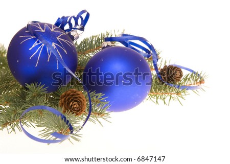 blue Christmas bulbs and conifer on white