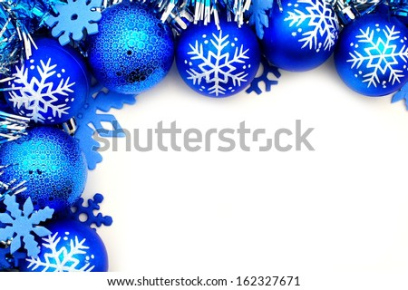 Blue Christmas corner border with baubles and snowflakes - stock photo