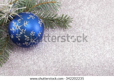 Blue Christmas decoration and fir tree on sparkling background. Celebrating Christmas - stock photo