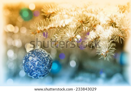 Blue christmas decoration ball hanging on tree - stock photo